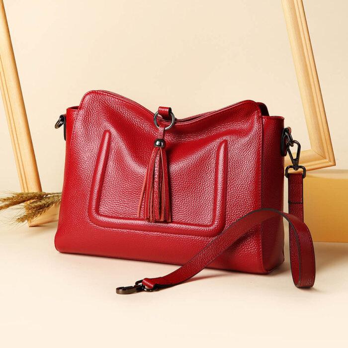 Custom-fashion-genuine-leather-handbag-with-tassels-CHB074-1